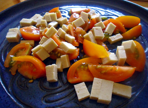 Dairy-free, gluten-free, soy-free cheese with garden tomatoes